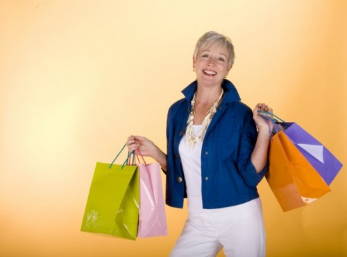 Senior Woman holding gift bags